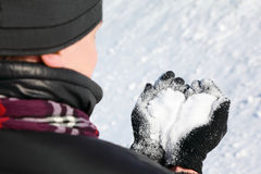 Nape of fellow which hold in hands snow Stock Photos