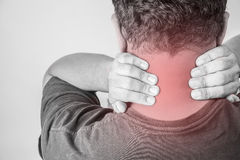 Nape injury in humans .nape pain,joint pains people medical, mono tone highlight at nape. ใ Royalty Free Stock Image