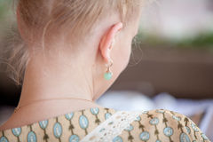 Nape of young blonde girl in retro dress Royalty Free Stock Photos
