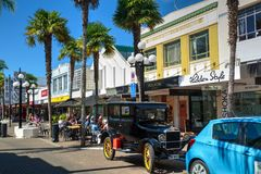 Napier, New Zealand. Historic car and historic buildings stock image