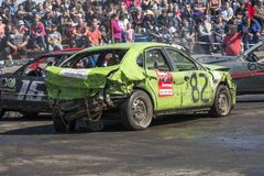 Wrecked cars in action during demolition derby Royalty Free Stock Image