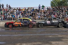 Wrecked cars in action during demolition derby Stock Photography