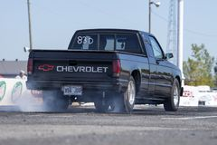 Chevrolet pickup on the track making a smoke show Stock Images