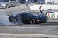 Corvette making a burnout on the track Stock Photography