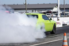Rear side view of dodge challenger making a smoke show. Napierville dragway super tour, june 2017 Royalty Free Stock Photo