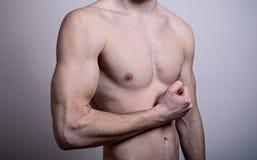Napinający męscy bicepsy Obraz Stock