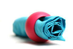 Napkin. Blue napkin and pink ring in white backgorund Stock Photo