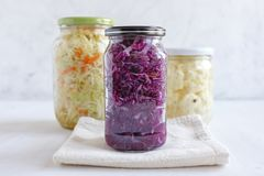 Napkin And Jars With Sauerkraut Royalty Free Stock Photo