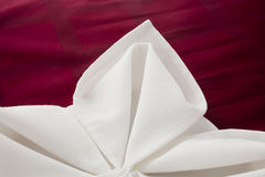 Napkin beautifully decorated. Linen napkin beautifully decorated on white background stock photos