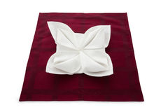 Napkin beautifully decorated. Linen napkin beautifully decorated on white background royalty free stock photo
