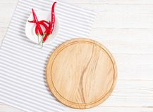 Napkin and board for pizza on wooden desk closeup, tablecloth. Canvas, dish towels on white wooden table background top view mock. Up. Selective focus stock photography