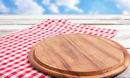 Napkin and board for pizza on wooden desk closeup, tablecloth. Canvas, dish towels on white wooden table background top view mock. Up. Selective focus royalty free stock image