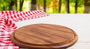 Napkin and board for pizza on wooden desk closeup, tablecloth. Canvas, dish towels on white wooden table background top view mock. Up. Selective focus royalty free stock photo