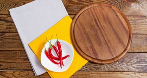 Napkin and board for pizza on wooden desk closeup, tablecloth. Canvas, dish towels on white wooden table background top view mock. Up. Selective focus royalty free stock images
