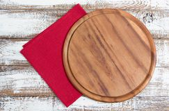 Napkin and board for pizza on wooden desk closeup, tablecloth. Canvas, dish towels on white wooden table background top view mock. Up. Selective focus stock photos
