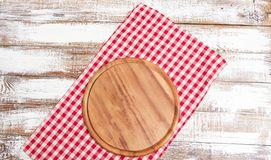 Napkin and board for pizza on wooden desk closeup, tablecloth. Canvas, dish towels on white wooden table background top view mock. Up. Selective focus royalty free stock photos