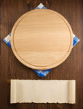 Napkin cloth and cutting board on wood Royalty Free Stock Photos