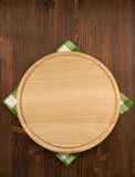 Napkin cloth and cutting board on wood Royalty Free Stock Image