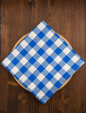 Napkin cloth and cutting board on wood Stock Photos