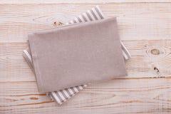 Napkin. Cloth napkin on white wooden background. Top view, mockup. Stock Photos