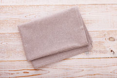 Napkin. Cloth napkin on white wooden background. Top view, mockup. stock photo