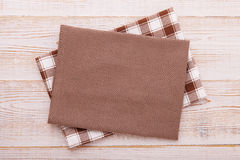 Napkin. Cloth napkin on white wooden background. Top view, mockup. Royalty Free Stock Image