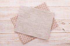 Napkin. Cloth napkin on white wooden background. Top view, mockup. Stock Photo