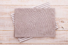 Napkin. Cloth napkin on white wooden background. Top view, mockup. Royalty Free Stock Photo