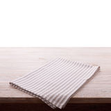 Napkin. Cloth napkin on white wooden table isolated. Perspective, mockup. Napkin. Cloth napkin on white wooden background. Top view, mock up Stock Photos