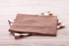 Napkin. Cloth napkin on white wooden table . Perspective, mockup. Stock Photos