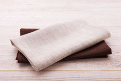 Napkin. Cloth napkin on white wooden table . Perspective, mockup. Napkin. Cloth napkin on white wooden background. Top view, mock up Royalty Free Stock Images