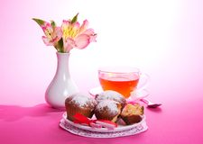 On a napkin cupcakes, tea and flowers Royalty Free Stock Image