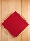 Napkin at cutting board on wood Stock Image