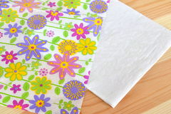 Napkin with flower pattern divided into 2 parts for decoupage. Home made paper diy. Paper crafts. Floral napkin. Floral pattern royalty free stock images