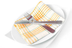 Napkin, folded on a plate with knife and fork Royalty Free Stock Images