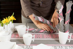 Napkin folding in the morning Stock Photos