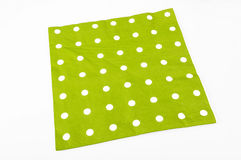 Napkin. Green napkin with white dots on the white background royalty free stock images