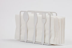 Napkin holder with cutlery forms Royalty Free Stock Photography