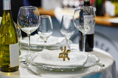 Napkin holder in form of spoon, fork and knife. On a wedding reception royalty free stock photo