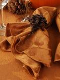 Napkin holders. Pine cone shaped napkin holders on a table setting Stock Photo
