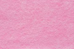Napkin household for cleaning, close-up. Background, texture. Viscose napkin household for dry and wet cleaning, pink color, close-up. Background, texture Royalty Free Stock Photo