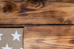Napkin on old wooden burned table or board for background.  Royalty Free Stock Photography