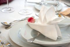Napkin in the plate. Wedding dinner Royalty Free Stock Photos