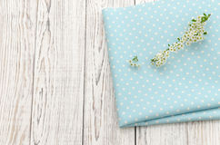 Napkin with polka dots and twig with white flowers Royalty Free Stock Image