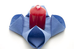Napkin with red candle Royalty Free Stock Photos