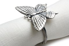Napkin with a ring in the form of a butterfly. Stock Photos