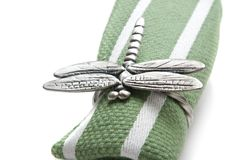 Napkin with a ring in the form of a dragonfly. Stock Photography