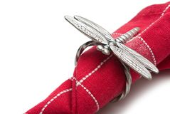 Napkin with a ring in the form of a dragonfly. Royalty Free Stock Images