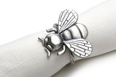 Napkin with a ring in the form of a fly. Stock Images