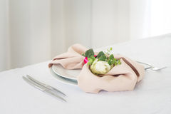 Napkin with rose. Wedding table setting. Indoor Royalty Free Stock Image